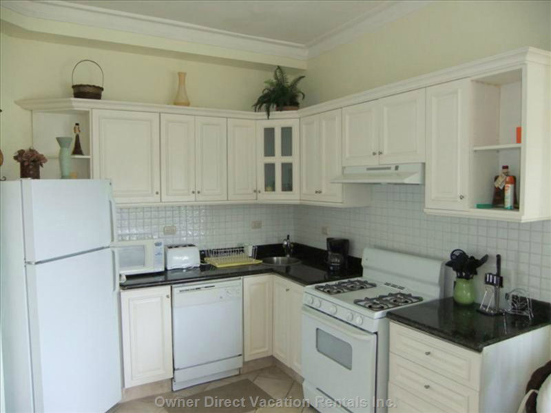 The Full Kitchen Offers Guest a Full Size Fridge with Freezer, Dishwasher, Stove, Water Cooler and all Utensils and Cookware.