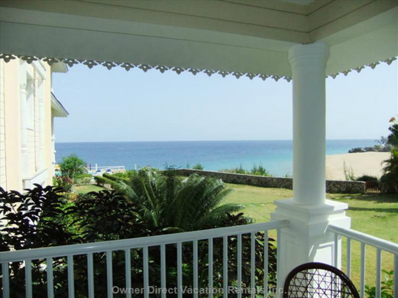 The Balcony Offers Guests a Relaxing View of the Ocean and the Beach Below. Perfect for Meals Outside, There is Seating for 4.