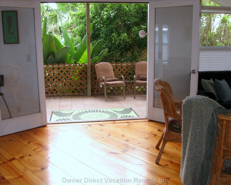 French Doors Open onto the Lush, Shady Back Porch.