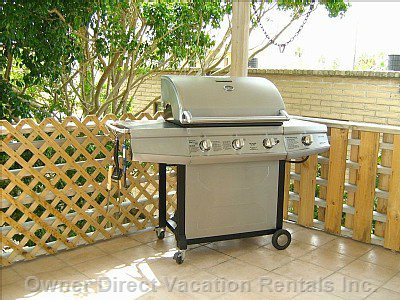 A Large Gas Grill Completes the Back Porch.