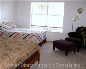 The Master Bedroom has 2 Queen Beds & Reading Area.