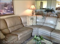 Living Room with Sectional Sofa W/Sleeper Bed.  Two Built-in Recliners that Allows you to Look Directly at Ocean.