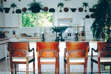 Four Mata Hari Stools Surround the Open Kitchen Island