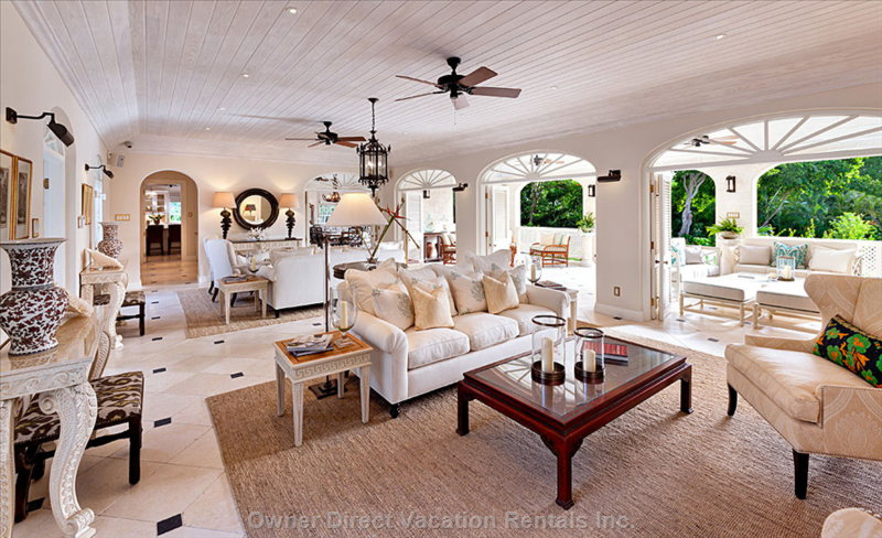 The Living Room Opens out to the Covered Patio Combining Indoor/Outdoor Living Seamlessly