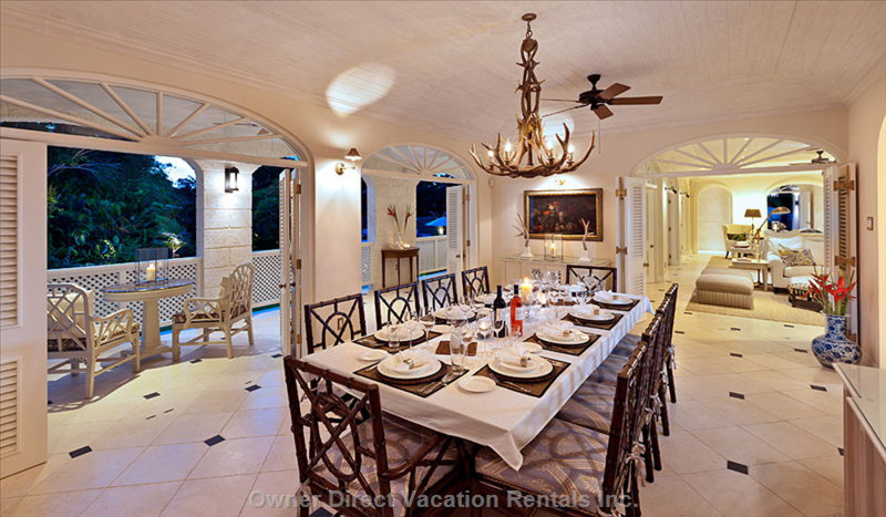 Formal Dining Room Opens out to the Covered Patio, Living Room and Walkway to the Gazebo; Includes Serving Area with Sink & Wine Cooler
