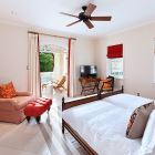 Ground Floor Bedroom Suite with Private Patio and Direct Access to the Pool Deck and Gardens