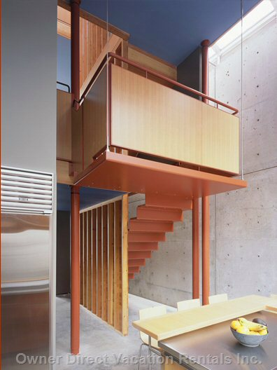 Hanging Stairs Leading to Ground Floor Dining Room, Bar, and Kitchen Area.