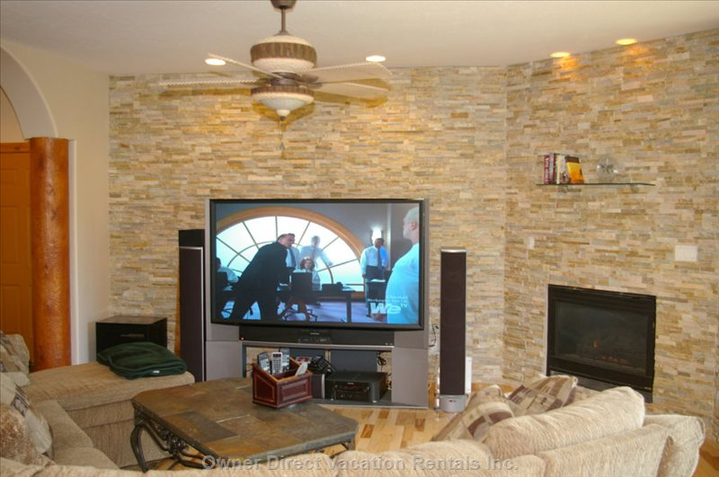 Main Level Family Room with Fireplace and 77inch TV