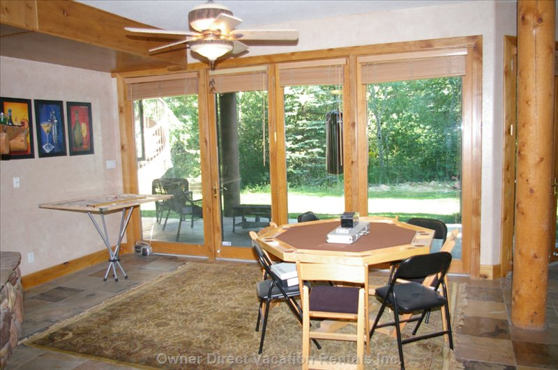 Lower Game Room with Gas Fireplace/Poker Table/Pocket Golf Table and Backyard Patio Area