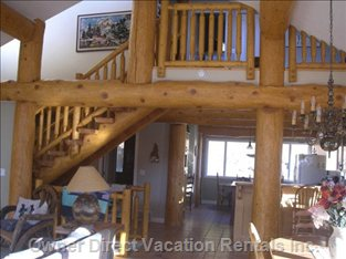 Log Post and Beam. - Log Stairs Lead to Open Loft Area, Bathroom and Two Bedrooms.