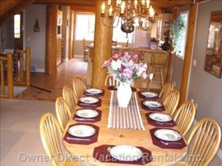 Dining Room Seating with Room for 10 Seats. - Spacious Pine Table and 10 Chairs in Open Concept Living Area.