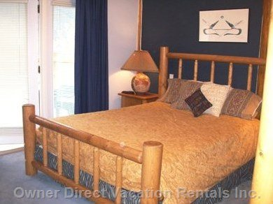 Master Bedroom with Log Furniture, French Doors to Terrace and Luxury Ensuite.