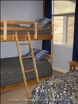 Single Bunk Beds plus Queen in both of the Upstairs Loft Bedrooms.
