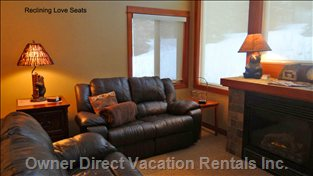 Living Room with Fireplace and Individual Reclining Love Seats
