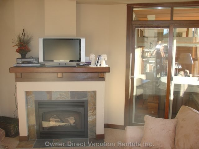 Living Room with Lcd TV and Fireplace