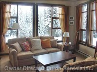 Living Room with Snowy Trees