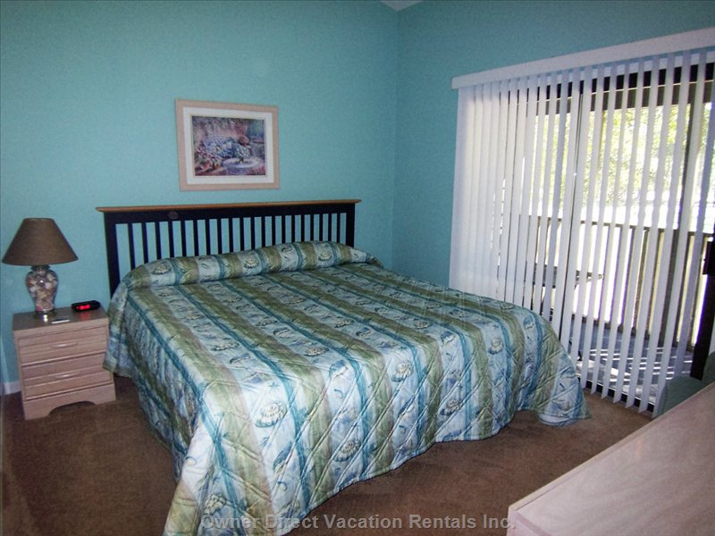 Golf Course Bedroom with King Bed, Private Bath, Tv, Direct Access to the Screened Porch.  Overlooks Maples #10.