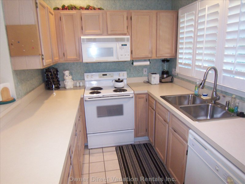 Fully Equipped Kitchen with Plenty of Counter Space and Small Dining Area.  There is Also a Larger Dining Area Seating 6.