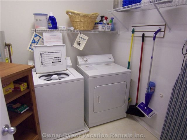 Large (but Not so Neat) Laundry Room with Plenty of Storage Shelving