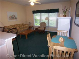 Living Room with Sofa, Easy Chair, Large TV, DVD, Stereo, Porch Access and more