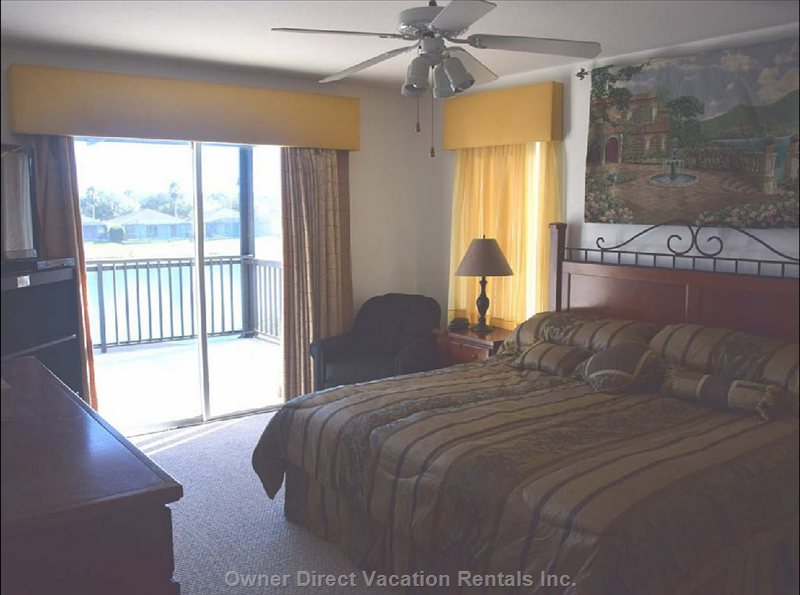 Upstairs Master Bedroom with Covered Balcony Overlooking Lake