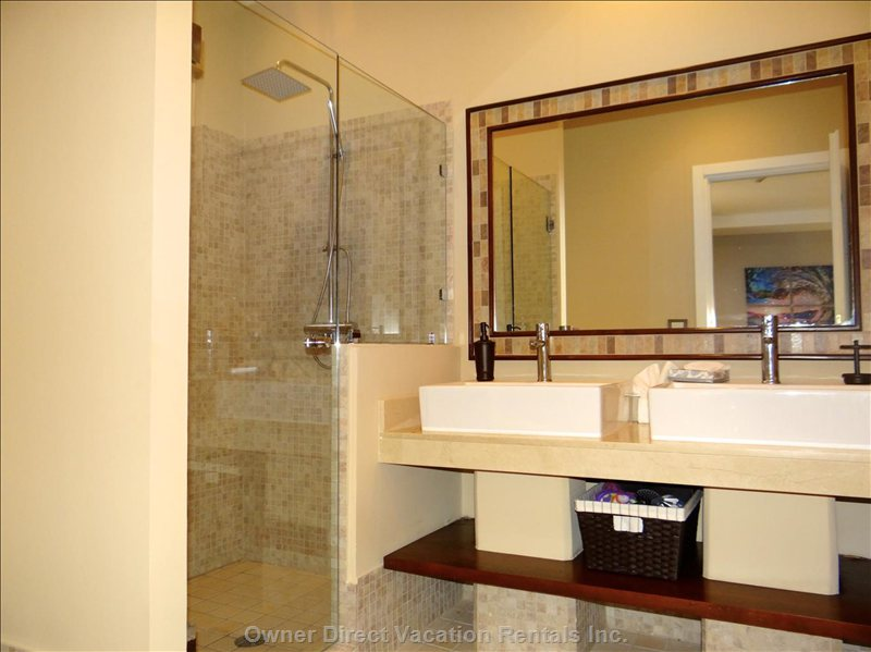 Master Bathroom with Dual Sinks and Rain Shower Head.