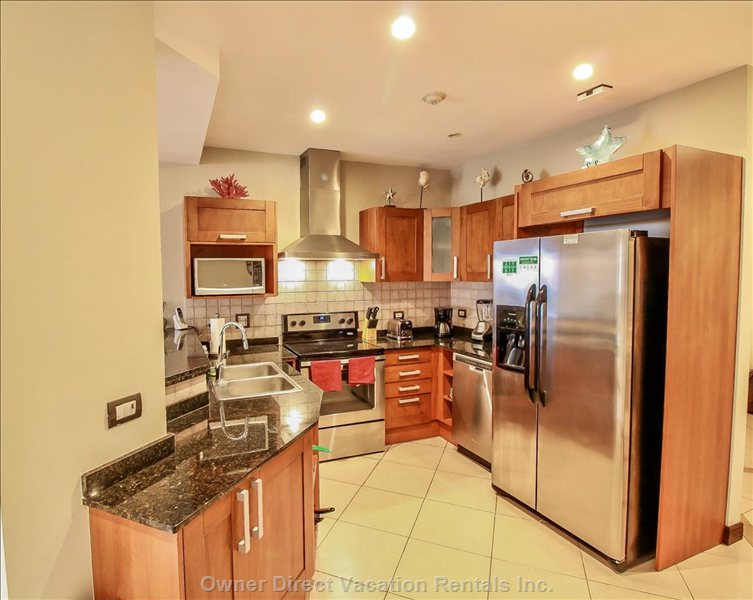 Kitchen with Stainless Steel Appliance, Granite Counters and all your Culinary Needs.