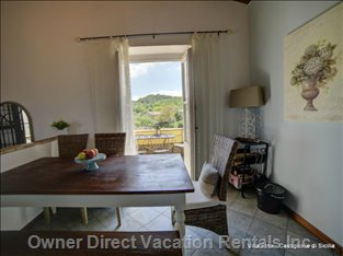 Dining Area with Access to the Lovely Balcony with Mount Etna Views