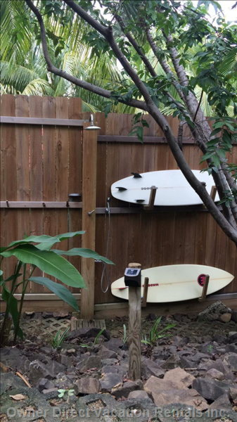 Rinse off in the Outside Shower after a Swim at the Beach and Store your Surfboards There