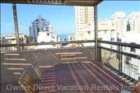 Rooftop Patio with Ocean View, Half the Roof is Covered and the other Half is Open. Ocean View on both Sides.