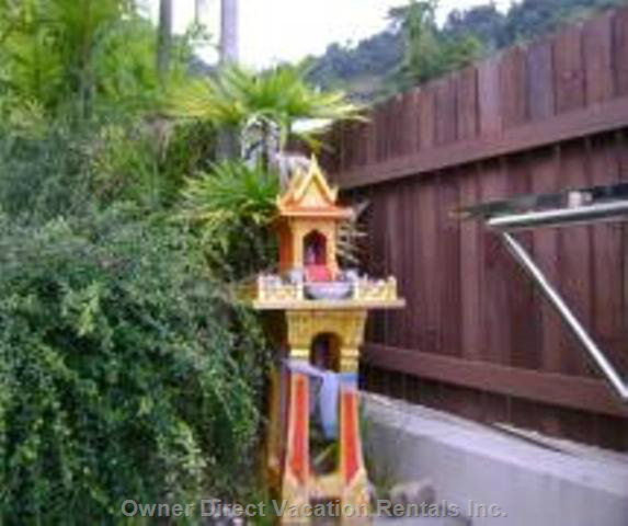 Remote Electric Gate and Buddhist Shrine