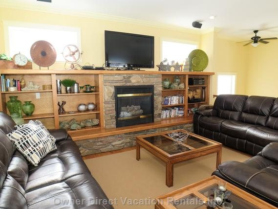 Spacious Living Room with Comfortable Couches and a Cozy Gas Fireplace