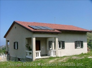 Rear View of House with Solar Panels