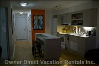 Kitchen with Fridge, Oven, Dishwasher - Center Island Also Turns into a Dining Table for 4 Or 6 People.