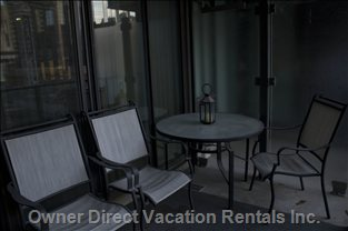 Private Balcony with Patio Set - 4 Chairs and a Table