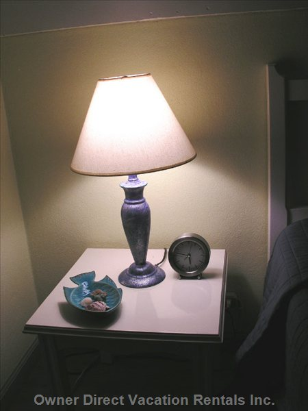 The Bedside Table Area Casts a Cozy Glow over the Bedroom