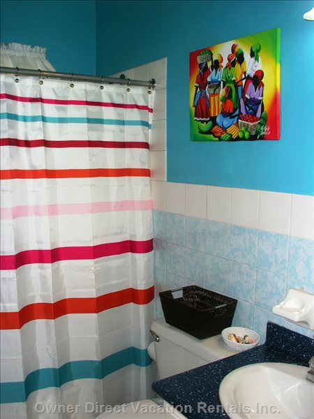 Bathroom with Bright Caribbean Colors and Artwork