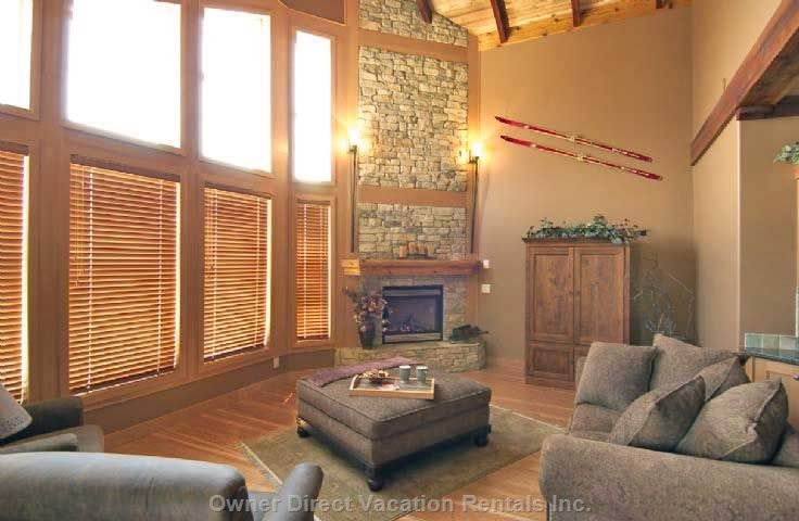 Living Room with 19 Foot High Heavy Wood Beam Ceiling