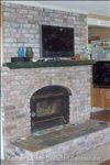 Living Room Side of Full Height, Double Sided Brick Fireplace