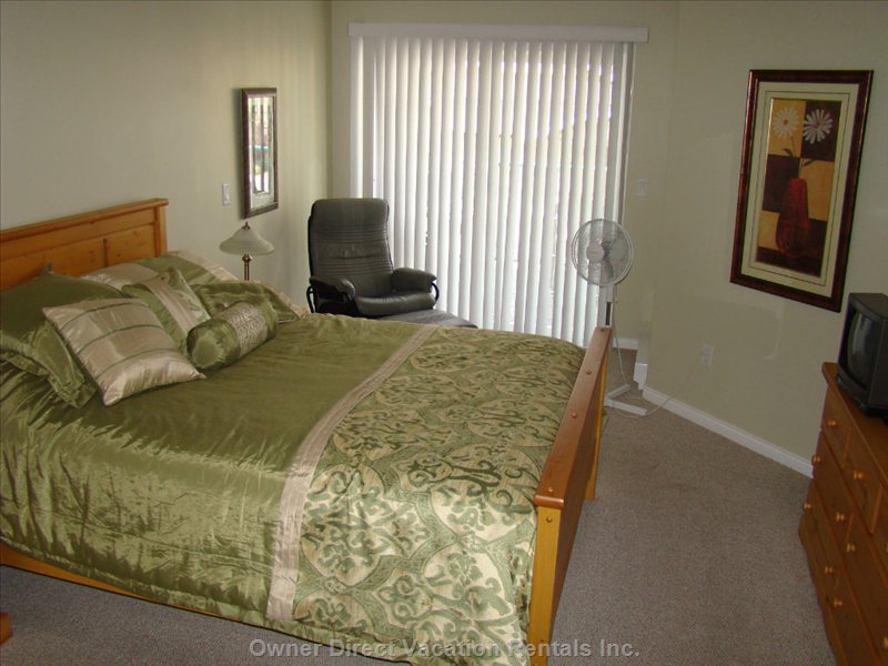 Nicely Furnished Queen Bedroom Suite with T.v., Lounge Chair and Sun Deck.