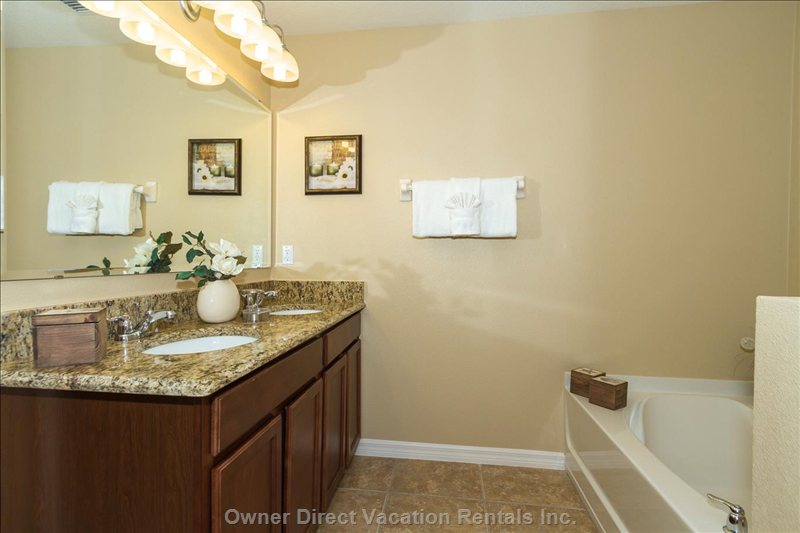 Master Suite Bathroom with Bath and Separate Double Sized Walk in Shower.