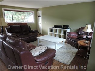 Comfortable Reclining Sofa and Chairs. 50 Inch hd Projector Satellite Tv. Great for Rare Rainy Summer Days Or Cozy Winter Night.