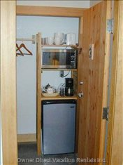 Mini-Kitchen- Microwave, Bar Fridge, Kettle, Coffee Maker W/Coffee,Tea, Sugar, Coffee Creamer Supplied. There is an Outdoor Shared Bbq.