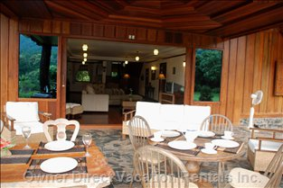 Outdoor Dining Room Looking into Living Room - this is Where Guests Can Enjoy Dining and Relaxing Throughout the Day.