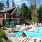 View of Pool Complex - Pool and Spa Complex. Offers Outdoor Whirlpool, Heated Swimming Pool and Separate Lap Pool. Interior Sauna and Steam Room. Lounge Chairs all around Pools to Relax in Summer.