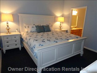 Master Bedroom En Suite with King Size Posterpedic Bed, Bathroom W/Garden Tub & Walk in Closet W/Safe   - Also 42 Inch Led TV