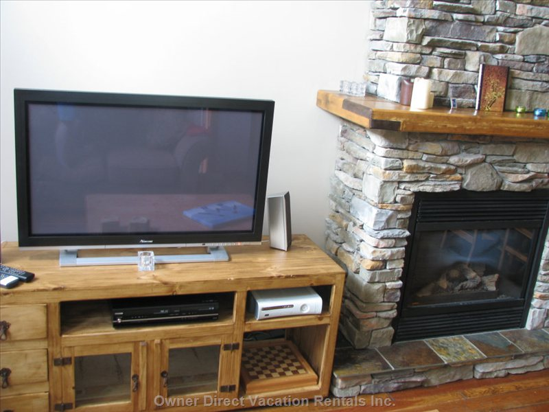 TV and Fireplace Main Lounge