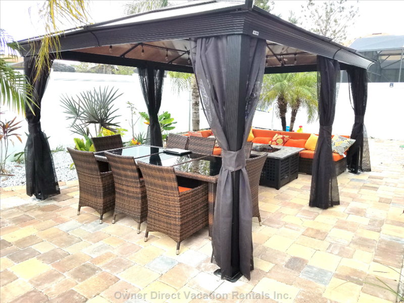 Dining and Sitting Area under a Sunshelter with Mosquito Netting