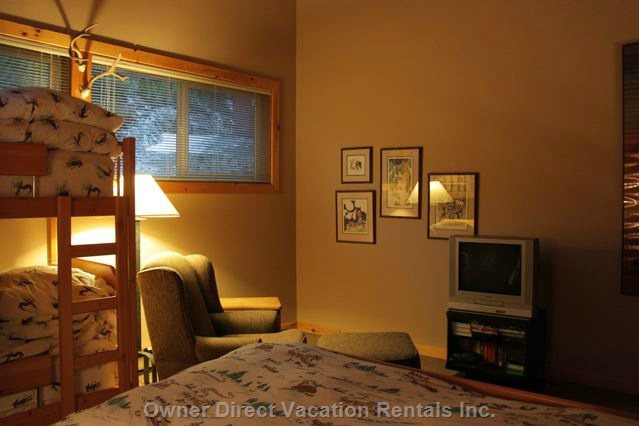 Loft Space Sleeps 4 Persons with a Queen Bed and Twin Bunks, DVD/Vhs Player and Easy Chair and Long 6 Drawer Dresser
