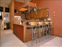 Breakfast Bar and Comfortable Bar Stools Looking into the Kitchen